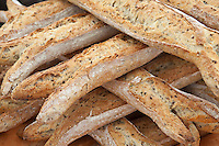 Freshly-baked multigrain 5 cereals French baguette bread on sale at food market at La Reole in Bordeaux region of France