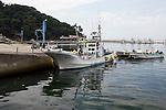 Photo shows fishing boats back in the water at Kyubun beach on the Oshika Peninsula, Ishinomaki City, Miyagi Prefecture, Japan on 04 Sept, 2011, 6 months after the mega-tsunami ripped through the area..Photographer: Robert Gilhooly