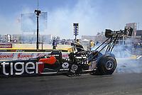 Apr 11, 2015; Las Vegas, NV, USA; NHRA top fuel driver Larry Dixon during qualifying for the Summitracing.com Nationals at The Strip at Las Vegas Motor Speedway. Mandatory Credit: Mark J. Rebilas-