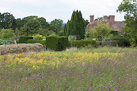View across a wildflower meadow to the house at Great Dixter