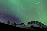 Star trails and the aurora borealis over the spire peak of mount snowden of the Brooks range.
