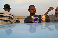 Baghdad, Iraq, June 2, 2003.Young baghdadis come on the bank of the tigris river at dusk to drink and hang out with friends. Alcoolism is on the rise in Baghdad as alcool can be purchased and drunk freely in public.