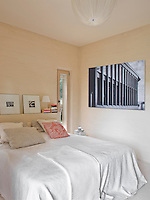 A large black and white architectural photograph is displayed on one of the bedroom walls