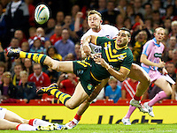 Picture by Alex Whitehead/SWpix.com - 26/10/2013 - Rugby League - Rugby League World Cup - Australia v England - the Millennium Stadium, Cardiff, Wales - Australia's Greg Inglis makes an acrobatic pass to set up Jonathan Thurston's try.