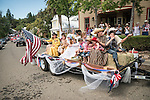 A float portraying historic characters from Moke Hill's past. Downtown main street during the Independence Day celebration Main Street, Mokelumne Hill, California