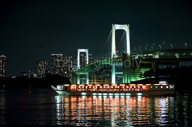 "The lights of a ""yakata-bune"" pleasure boat are reflected in the calm waters of Tokyo Bay, Japan on 31 August  2010. .Photographer: Robert Gilhooly"