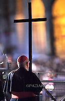 Cardinal Agostino Vallini.Pope Francis holds the wooden cross during the Via Crucis (Way of the Cross) torchlight procession on Good Friday in front of the Colosseum in Rome. .April 4, 2015