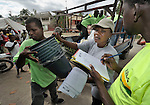 Relief aid is unloaded in Jacmel, a town on Haiti's southern coast that was ravaged by the January 12 earthquake.