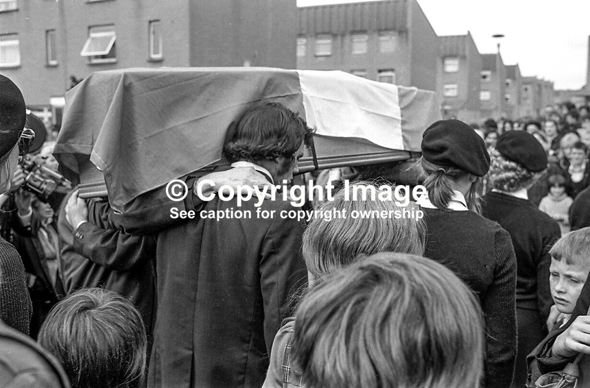 Funeral of Provisional IRA leader, James Bryson, 26 years, married, of Ballymurphy Road, Belfast, N Ireland, on its way to  Milltown Cemetery. Bryson, one of seven escapees from the prison ship Maidstone was shot by the British Army on 22nd September 1973. Another man, Patrick Mulvenna, travelling in the same car was shot dead. A third passenger in the car was injured. The British army alleged that Bryson using an armalite with a telescopic sight had been responsible for the deaths of several soldiers and policemen. 197309250594c.<br />