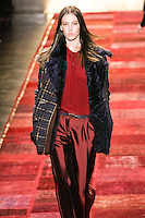 Model walks runway in an outfit from the Tommy Hilfiger Fall 2011 Bohemian Prep collection, during Mercedes-Benz Fashion Week Fall 2011.