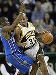 .Seattle SuperSonics  Ray Allen drives against an Orlando Magic defender in NBA basketball action    in the quarter Wednesday, Jan. 11, 2006 in Seattle.  Jim Bryant Photo. &copy;2010. All Rights Reserved.
