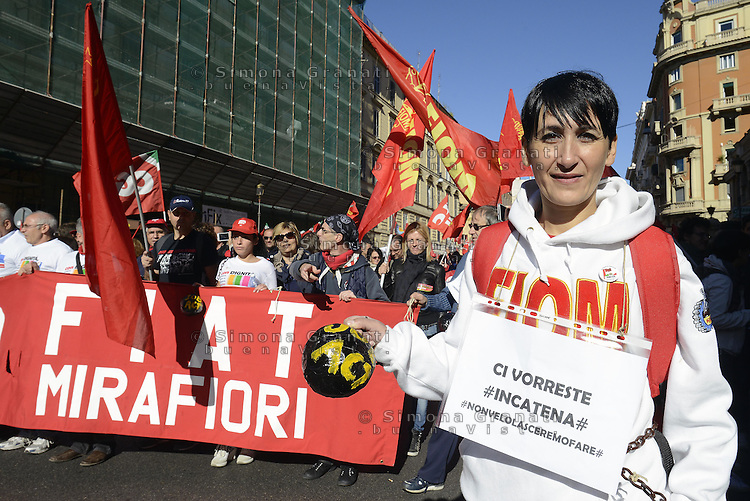 Roma, 25 Ottobre 2014<br /> Lavoro. La CGIL manifesta a Roma con due cortei nazionali fino a Piazza San Giovanni , contro il jobs act e la riforma dell'art.18 del governo Renzi.<br /> Fiat Mirafiori<br /> <br /> CGIL protest against the jobs act and the reform of article 18 of the government Renzi.<br /> <br /> Rome, October 25, 2014 <br /> Work. The national union CGIL manifested in Rome with two national marches to Piazza San Giovanni, against the jobs act and the reform of article 18 of the government Renzi.