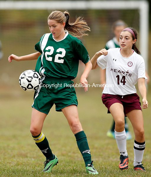 Waterbury, CT- 30 September 2015-093015CM07-   Holy Cross' Jordan Gilmore (22) controls the ball away from Sacred Heart's Brianna Dyr during their NVL matchup at Bucks Hill Park in Waterbury on Wednesday.    Christopher Massa Republican-American