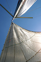Looking up at sails from deck of sailboat on Lake Erie.