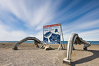 Welcome to Utqiagvik (Barrow), Alaska sign, Arctic ocean in the background.