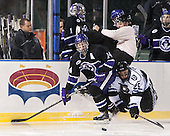 Adam Schmidt (HC - 14), Brett Switzer (Bentley - 25), Billy McGoldrick - The Bentley University Falcons defeated the College of the Holy Cross Crusaders 3-2 on Saturday, December 28, 2013, at Fenway Park in Boston, Massachusetts.