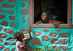 A woman talks with her daughter as she looks out the window of her house in Despagne, an isolated village in southern Haiti where the Lutheran World Federation has been working with residents to improve their quality of life.