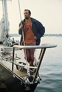 29 Jun 1976, Newport, Aquidneck Island, Rhode Island, USA. French sailor Eric Tabarly arrives in Newport aboard the Pen Duick VI after winning the OSTAR transatlantic race for the second time. The 1976 edition of the Observer Single-Handed Trans-Atlantic Race (OSTAR) was the largest edition of the race, in the number of participants and the length of boats. Image by © JP Laffont