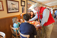 Bob Moore of Bob's Red Mill enter acting with customers and employees at Bob' Red Mill Restaurant and Store in Milwaukee Oregon