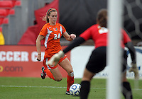 COLLEGE PARK, MD - OCTOBER 28, 2012:  Rachelle Beanlands (33) of the University of Maryland defends against Tara Schwitter (24) of Miami during an ACC  women's tournament 1st. round match at Ludwig Field in College Park, MD. on October 28. Maryland won 2-1 on a golden goal in extra time.