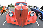 Classic Car, orange Ford seen from tall front chrome grille, 180 degree fisheye lens view, at Custom Classic Car Meet at parking lot of Cradle of Aviation Museum, Garden City, New York, on July 21, 2011.