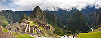 """Huayanapichu (young mountain) in the distance at Machu Picchu, the ancient """"lost city of the Incas"""", 1400 CA, 2400 meters. Discovered by Hiram Bingham in 1911. Urubamba river in the distance."""