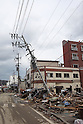 March 17, 2011, Kesennuma CIty, Iwate Prefecture, Japan - Power lines hang tilted over the tsunami debris clogging Kesennuma, Iwate Prefecture, Japan, inthe aftermath of the 2011 Tohoku-Kanto Natural Disaster. (Photo by Yousuke Miyamori/AFLO)