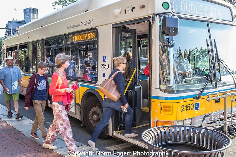 People boarding a bus in Harvard Square, Cambridge, MA