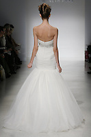 Model walks runway in a Lizzette wedding dresses by Amsale Aberra, for the Kenneth Pool Spring 2012 Bridal runway show.