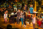 Pink Martini with Thomas Lauderdale on piano rehearsing with the Oregon Symphony with the von Trapps at the Arlene Schnitzer concert hall in Portland, Oregon.  The woman in a white sweater is Charmian Carr who played Lisle in the original Sound of Music