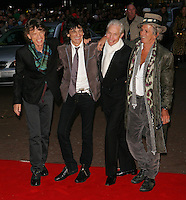 """THE ROLLING STONES - Mick Jagger, Keith Richards, Charlie Watts and Ronnie Wood at the premiere of """"Shine A Light"""" at the Odeon Leicester Square cinema."""