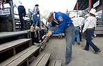 Ranked Number 1 in the world in the Bareback Riding event, Clint Cannon, tucks his jeans in his boots at the Kitsap County Fair and Stampede Thursday, Aug. 26, 2009. Cannon won the event with an 87.  Jim Bryant Photo. All Right Reserved. © 2009