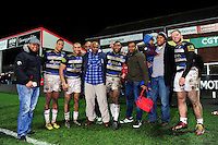Anthony Watson, Jonathan Joseph, Semesa Rokoduguni and Max Lahiff of Bath Rugby pose for a photo with family members after the match. Aviva Premiership match, between Gloucester Rugby and Bath Rugby on March 26, 2016 at Kingsholm Stadium in Gloucester, England. Photo by: Patrick Khachfe / Onside Images