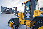 Merrick, New York, USA. January 24, 2016. After Nor'easter drops more than two feet of snow on south shore of Nassau County, Long Island, many Town of Hempstead Highway Department employees work long hours operating snow ploys to plows to remove about 25 inches of snow blanketing downtown streets and public parking lots.