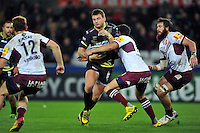 Dan Biggar of the Ospreys takes on the Bordeaux Begles defence. European Rugby Champions Cup match, between the Ospreys and Bordeaux Begles on December 12, 2015 at the Liberty Stadium in Swansea, Wales. Photo by: Patrick Khachfe / JMP