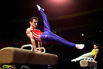 Pommel horse gold medalist Marius Urzica, left, from Romania and Wei Yang, right, from China perform a doubles pommel horse routine during the Sydney 2000 Olympics Gymnastics Gala at the Super Dome in Sydney, Australia, Tuesday Sept. 26, 2000. The gala featured gold medalist and renowned gymnasts from various gymnastic disciplines. (AP Photo/ Victoria Arocho)