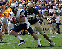 Pitt defensive end Jabaal Sheard tackles New Hampshire quarterback R.J. Toman. The Pittsburgh Panthers defeat the New Hampshire Wildcats 38-16 at Heinz Field, Pittsburgh Pennsylvania on September 11, 2010.