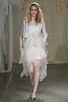 Model walks runway in a Sweet Bay Short wedding dress by Carol Hannah Whitfield, for the Carol Hannah Spring Summer 2012 Bridal collection runway show.