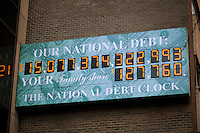 The National Debt Clock in New York  showing the US debt as over $15 trillion is seen on Sunday, December 11, 2011.  Real-estate mogul, the late Seymour Durst, created the clock on Feb. 20, 1989 to call attention to  Reaganomics. (© Richard B. Levine)