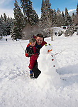 California, Lake Tahoe: Child makes a snow man at  North Lake Tahoe Regional Park.  Photo copyright Lee Foster.  Photo # cataho107572