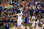 31 MAR 2012:  Anthony Davis (23) of the University of Kentucky tries to block the shot of Elijah Johnson (15) of the University of Kansas in the championship game of the 2012 NCAA Men's Division I Basketball Championship Final Four held at the Mercedes-Benz Superdome hosted by Tulane University in New Orleans, LA. Kentucky defeated Kansas 67-59 to win the national title. Brett Wilhelm/NCAA Photos