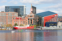 Tourists enjoy paddle boats near the Baltimore National Aquarium and Lightship Chesapeake in Baltimore, Maryland.