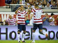 Jacksonville, FL - Saturday, May 26, 2012: Landon Donovan, left, and Jermaine Jones celebrate as the USMNT defeated Scotland 5-1 during an international friendly match.