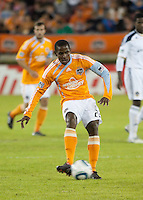 Lovel Palmer of the Houston Dynamo strikes the ball during the regular season game between the Los Angeles Galaxy and the Houston Dynamo at Robertson Stadium in Houston, TX on April 10, 2010. Los Angeles 2, Houston 0.