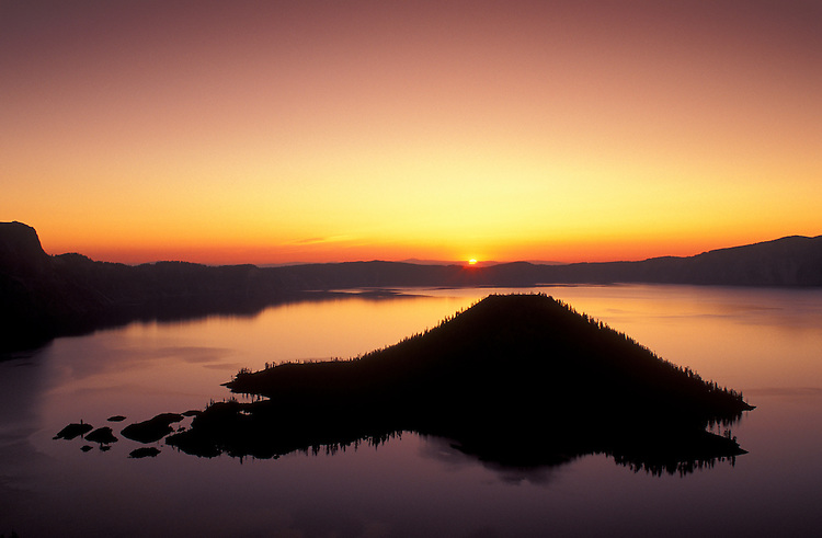 Wizard Island at sunrise, Crater Lake National Park, Oregon.