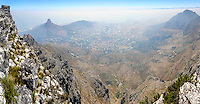 Table Mountain is a flat mesa  overlooking the city of Cape Town in South Africa. Lion's Head and Signal Hill to the west. Panorama.