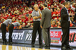 UK head coach Jeff Walz asks about a questionable call as his assistant Matt Insell reacts. The other two referees are huddled over the officials bench area watching the replay in order to make the correct call. in Louisville, Ky., on Sunday, December, 2, 2012. Photo by James Holt | Staff
