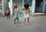 """In the capital of the Philippines, children play in the Manila North Cemetery. Hundreds of poor families live here, dwelling in and between the tombs and mausoleums of the city's wealthy. They are often discriminated against, and many of their children don't go to school because they're too hungry to study and they're often called """"vampires"""" by their classmates. With support from United Methodist Women, KKFI provides classroom education and meals to kids from the cemetery at a nearby United Methodist Church."""
