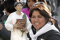A faithful, holding a statue of Pedro Calungsod, Pope Benedict XVI named today seven new saints, Kateri Tekakwitha of the US, Jacques Berthieu of France, Maria Anna Cope of Germany, Pedro Calungsod from the Philippines, Maria Schaffer of Germany, Giovanni Battista Piamarta of Italy, Maria del Carmen of Spain, in St. Peter square at the Vatican, 21 October, 2012