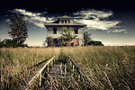 Derelict house in countryside scene in America